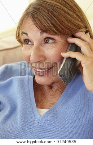 Senior Hispanic Woman Using Cellphone At Home