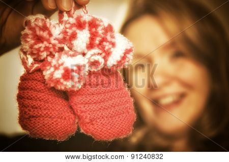 Blond Woman With Baby Shoes