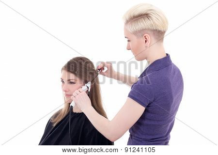 Female Hairdresser Curling Hair To Young Beautiful Woman Isolated On White