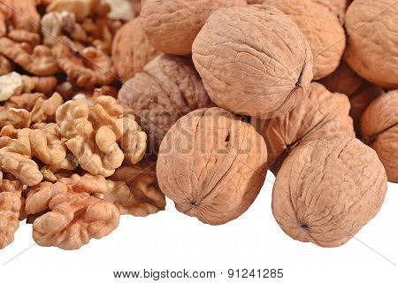 Heap Of Walnuts On A White