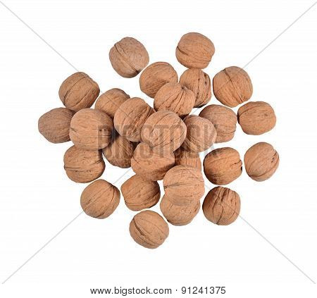 Heap Of Whole Walnuts On A White