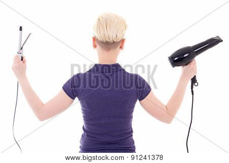 Back View Of Young Woman Hair Stylist Posing With Hairdryer And Curler Isolated On White