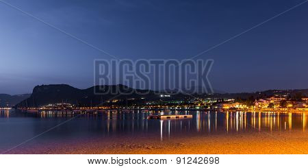 village bardolino italy at night with reflections in lake