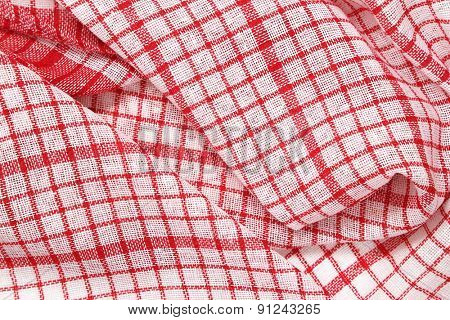 detail of red and white crumpled dishtowel