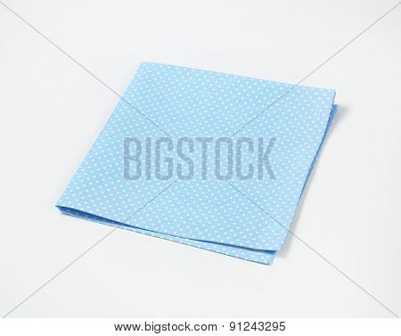 turquoise dotted place mat on white background