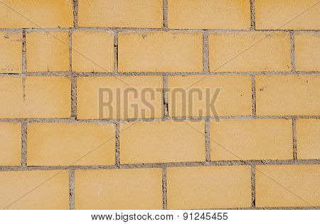 Photo of a building blocks forming a yellow wall