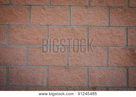Photo of a building blocks forming a red wall