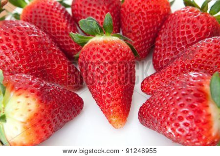 Delicious red strawberries on a white plate