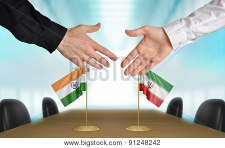 India and Iran diplomats agreeing on a deal