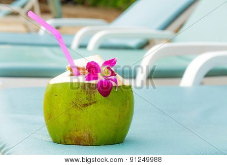 Sunbathing with coconut drink