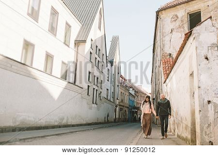 Young Couple Walking In The City In A Day