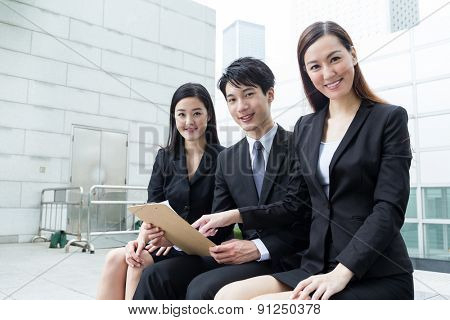 Group of business team member hold with clipboard