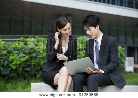 Businessman show with the project plan with businesswoman