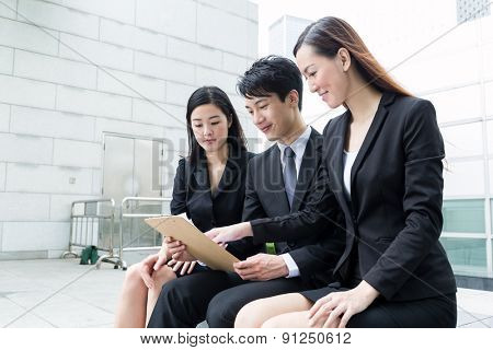 Group of business team mamber read on clipboard