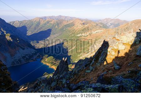 Mountain landscape with lake in the valley.