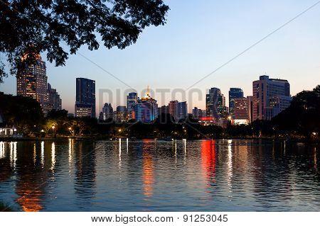 Panorama View On Bangkok From Lumpini Park. Night View Over The Lake. Bangkok, Thailand.