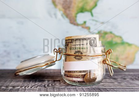 Collecting Money For Travel. Glass Tin As Moneybox With Cash Savings (banknotes And Coins)
