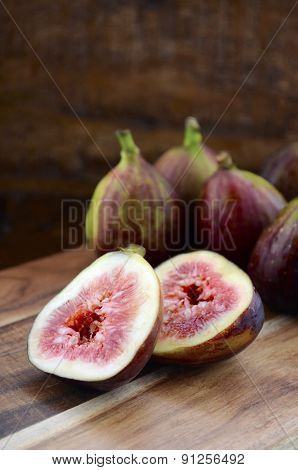 Fresh Figs On Dark Wood Table Setting.