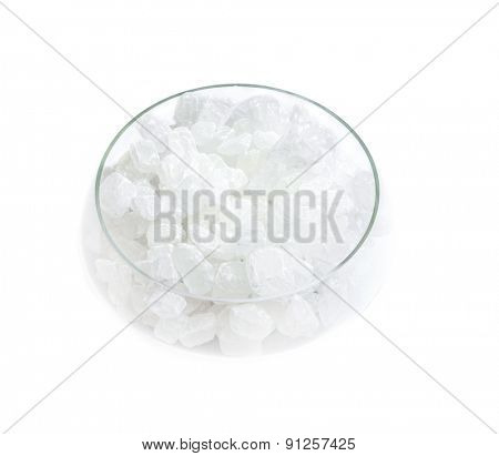 crystal sugar in a glass sugar bowl isolated on a white background