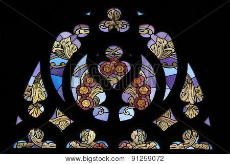 KUTNA HORA, CZECH REPUBLIC - AUGUST 24, 2014: Art Nouveau floral pattern at the stained glass window in Saint Barbara Church in Kutna Hora, Czech Republic.
