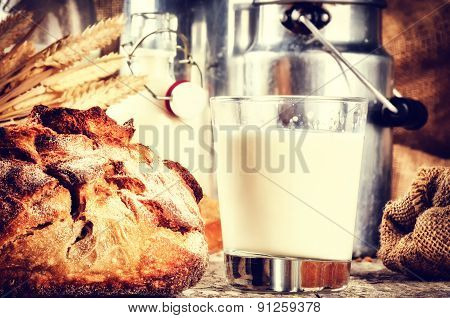 Glass Of Fresh Milk And Bread In Country Setting