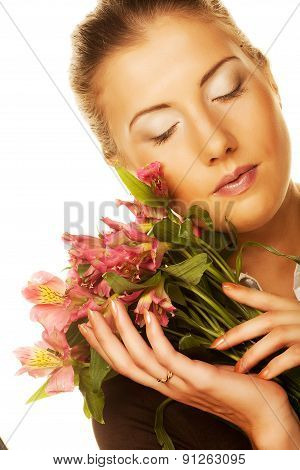 Young woman with pink flowers.