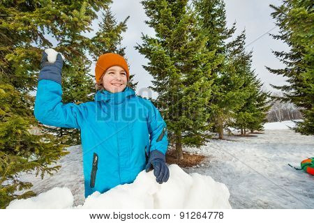 Boy ready to throw snowball during game