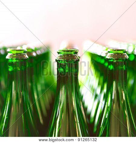Many bottles on conveyor belt