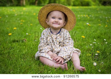 Adorable Baby Girl Smiling In A Park