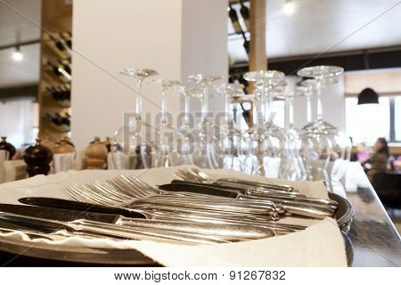 Empty wine glasses and forks, knives on a table at restaurant