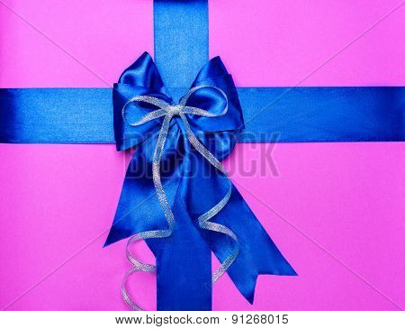 blue bow made from silk on pink