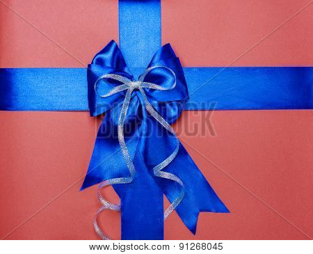 blue bow made from silk on brown