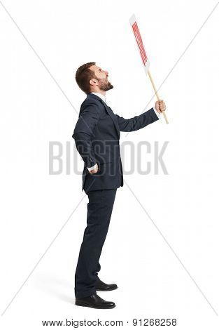 sideview of screaming businessman in formal wear holding placard with stop sign. isolated on white background