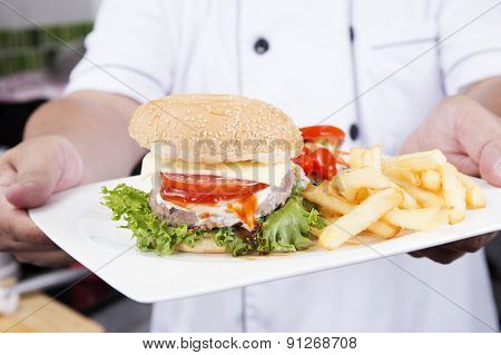 Chef Presented Plate Of Hamburger