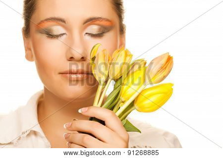 woman with yellow tulips  over white