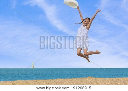 Girl Jumping Over The Water At The Beach