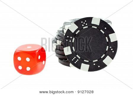 Black Poker Chips And Red Dice Cube Isolated