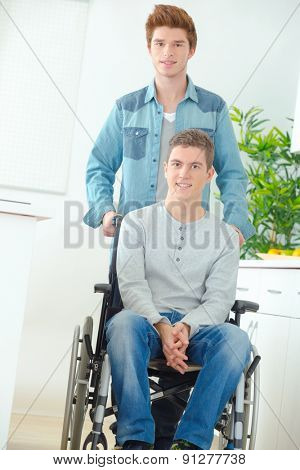 Teenager in wheelchair and his friend