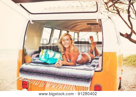 Beach Lifestyle, Beautiful Surfer Girl Relaxing in Classic Vintage Surf Van on the Beach at Sunset