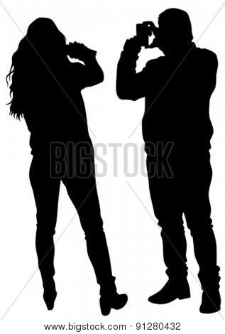 Man and woman with a camera on white background