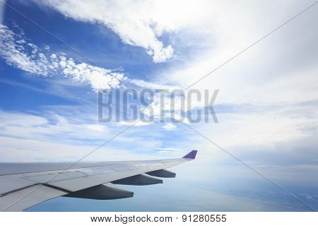 View Of Cloud With Wing Of Airplane From Window