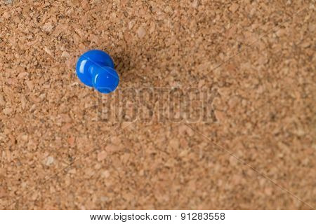 Single Thumb Tack On Cork Board