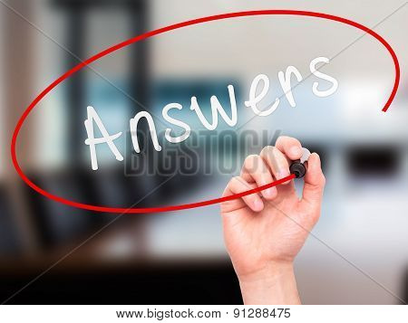 Man Hand writing Answers with marker on transparent wipe board.
