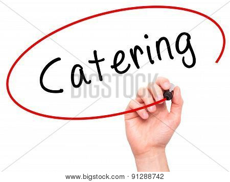 Man Hand writing Catering with marker on transparent wipe board.