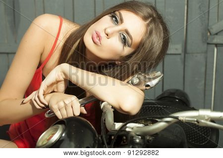 Portrait Of Beautiful Sexy Young Girl  With Spanner