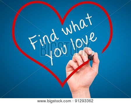 Man Hand writing Find what you love with marker on transparent wipe board, inside heart shape.
