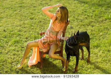 Beautiful Woman In Peach Dress With Mastiff