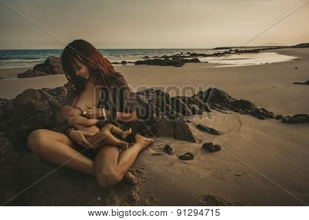 Portrait of a mother with Newborn Baby in the beach