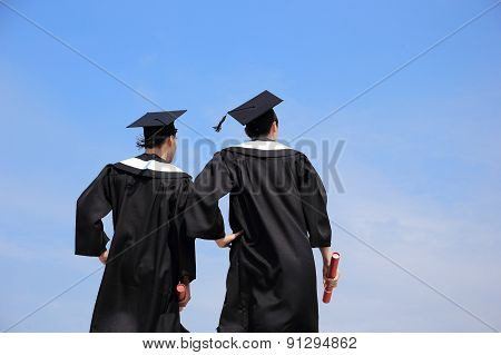Back View Of Graduates Student