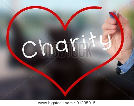 Hand writing Charity inside heart shape.